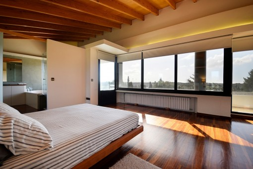 Spacious master bedroom with panoramic views