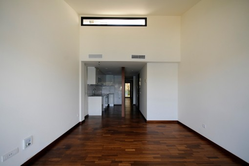 The kitchen is located directly on the bright living room