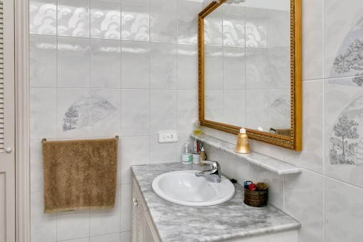 Bright bathroom with elements of marble