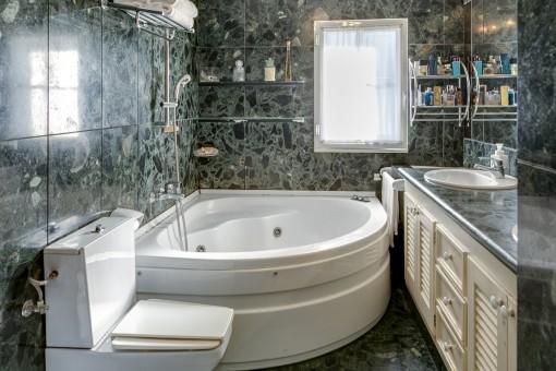 Bathroom with large bathtub