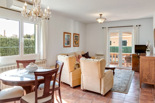 Bright living and dining area with terrace access