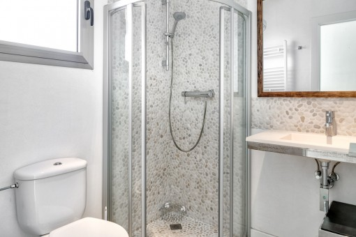 The third bathroom with beautiful stone wall