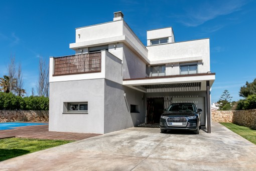The villa is surrounded by a private garden and has a garage