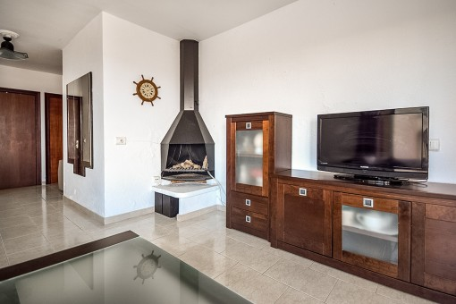 Alternative view of the living area with fire place