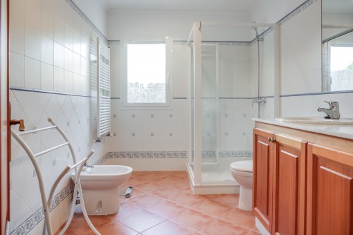 Bathroom with shower and double-washbasin