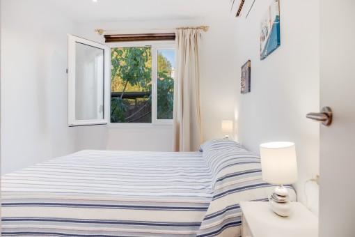 Bright bedroom with garden views