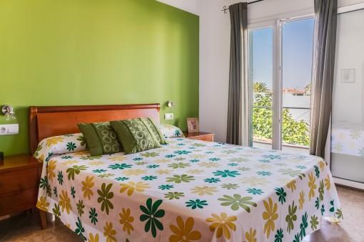 Main bedroom with balcony access