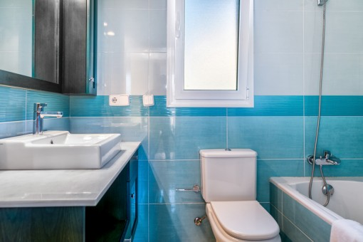 Blue bathroom with bathub