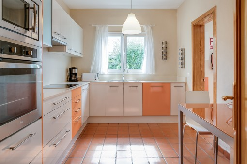 Bright and fully-equipped kitchen