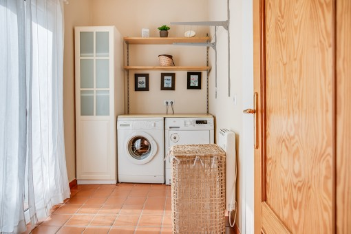Charming laundry room with dryer