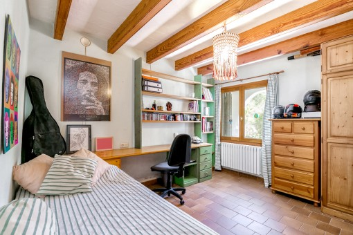 Single bedroom with wooden ceiling beams