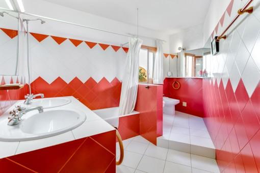 Red bathroom with bathtub