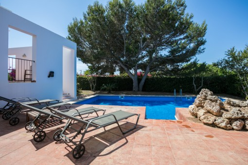 Inviting pool area with sun loungers
