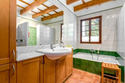 Bathroom with window and bathtub