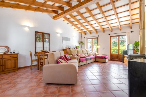 Ample living area with wooden ceilng beams