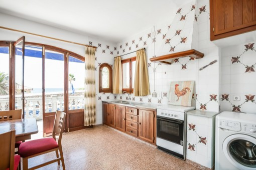 Further kitchen with sea views