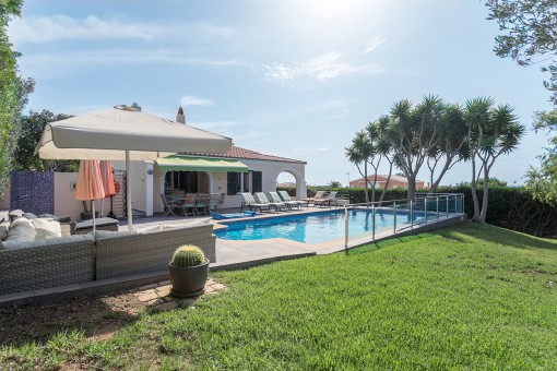 Garden and pool with sea views