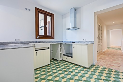 Kitchen with beautiful tiled floor