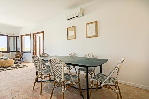 Birght dining area with terrace access
