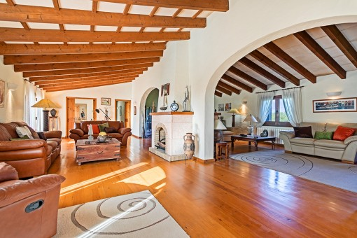 Large living area with wooden ceiling beams