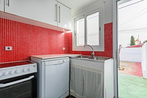 First kitchen with terrace access